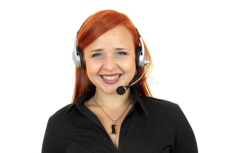 Centrum telefoniczne uśmiechnięty operator z telefon słuchawki fotografia stock