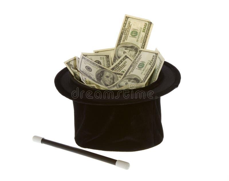 Cents billets d'un dollar dans un chapeau magique avec la baguette magique photo libre de droits