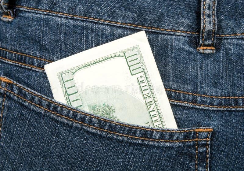 Cents dollars de billet de banque dans la gratte-cul-poche de jeans photo stock