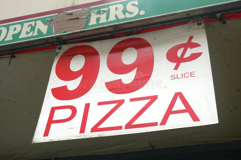 99 Cents Pizza Slice. One of the few culinary deals in New York City: a pizza slice for 99 cents stock photos