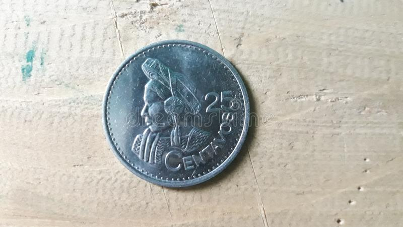 25 cents from quetzal, Guatemala. Ndenomination of 25 cents of quetzal, republic of Guatemala, profile portrait of Concepción Ramírez, indigenous woman stock image