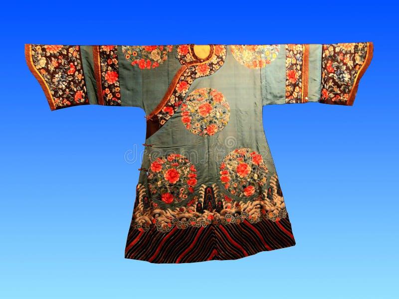 A century ago, Chinese silk court dress. Hangzhou China silk museum exhibits royalty free stock image