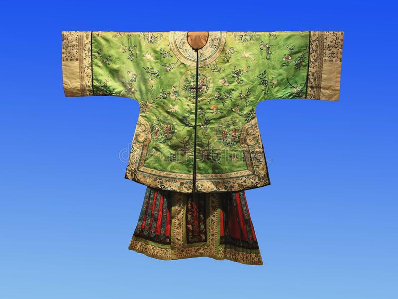 A century ago, Chinese silk court dress. Hangzhou China silk museum exhibits royalty free stock photos