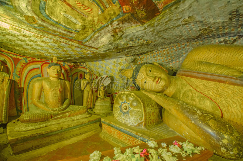 12 Century Dambulla Cave Golden Temple And Statues. Dambulla Cave Golden Temple Is The Largest And Best-Preserved Cave Temple Complex In Sri Lanka stock photos