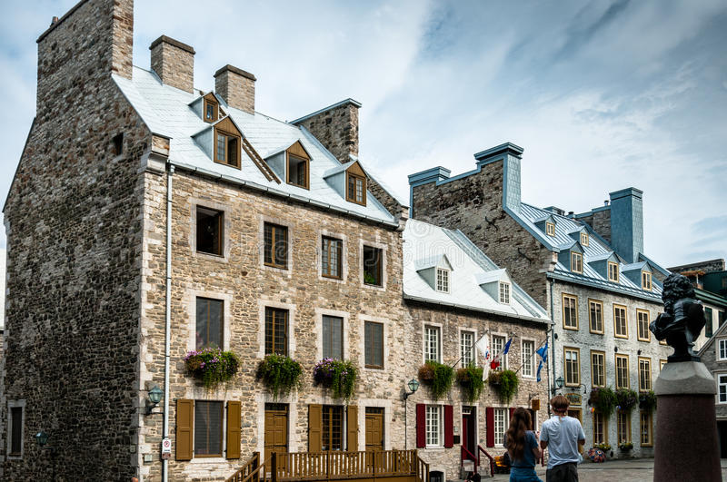 Century houses in Place Royale. People looking at the century houses in Place Royale old Quebec city Canada royalty free stock image