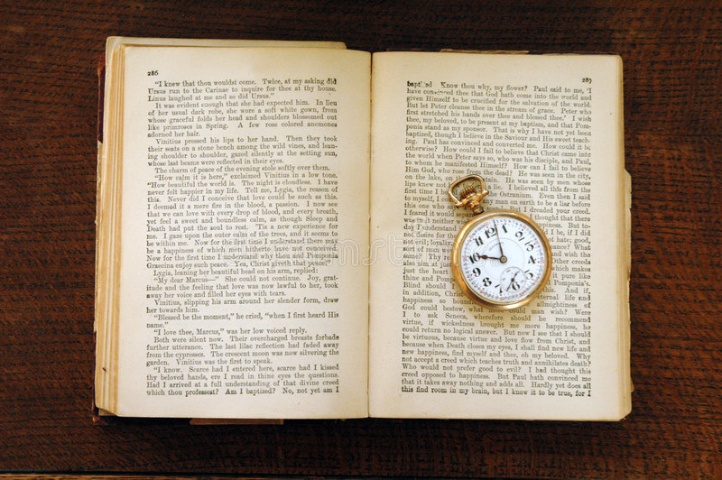 Century Old Book And Pocket Watch Stock Images