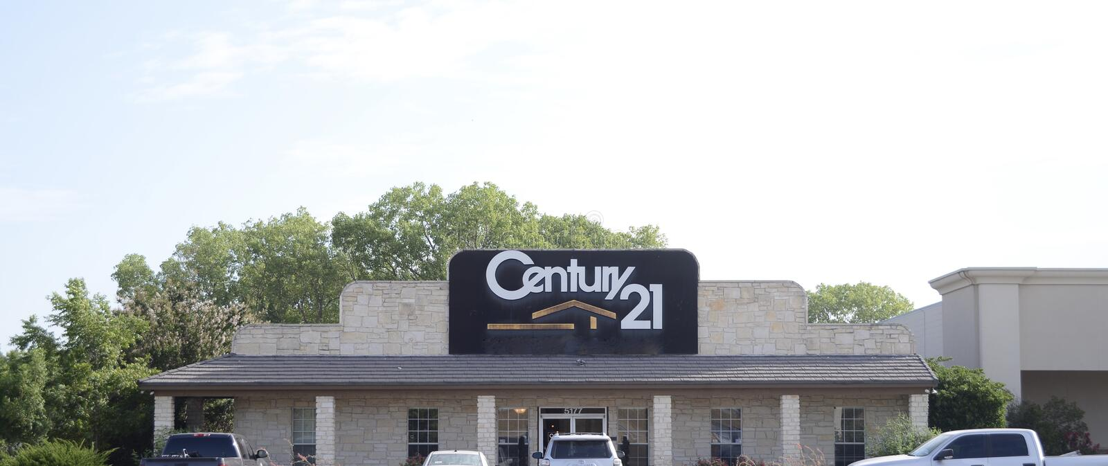 Century 21 Real Estate Company. Century 21 Real Estate is an American real estate agent franchise company founded in 1971, that sells homes, commercial property royalty free stock photography