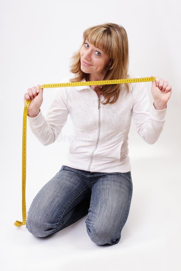centymetrowa dziewczyna pokazywać uśmiechy zdjęcia stock