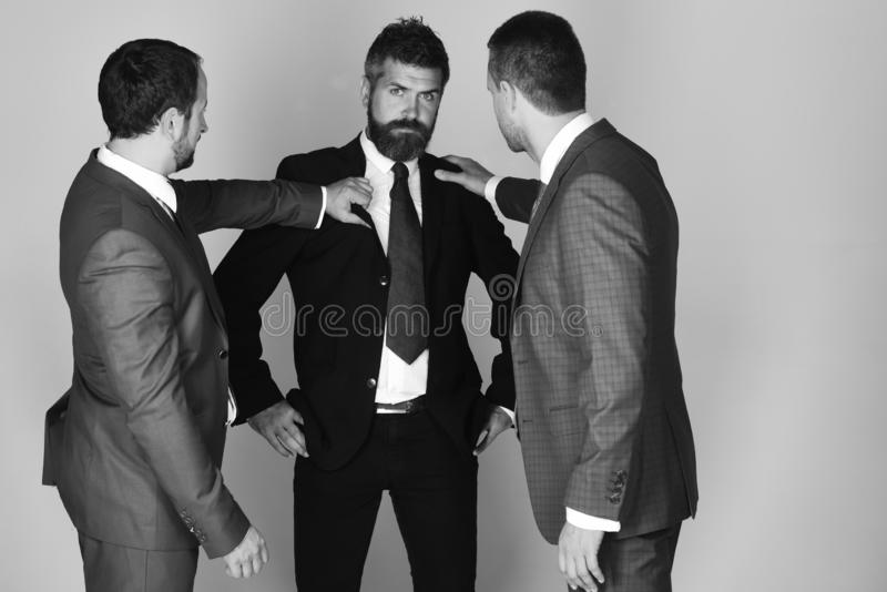 CEO cannot find compromise on light grey background. CEO argue and try to find compromise on light grey background. Businessmen wear smart suits and ties stock photos