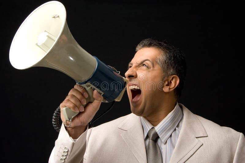 CEO che grida tramite il megafono immagini stock