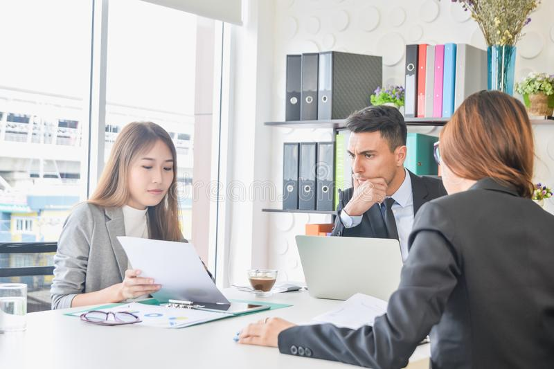 CEO or chief financial officer sees financial summary reports with his secretary team or discusses goal future project royalty free stock photos