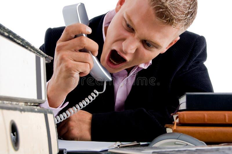 CEO novo que shouting no telefone imagem de stock