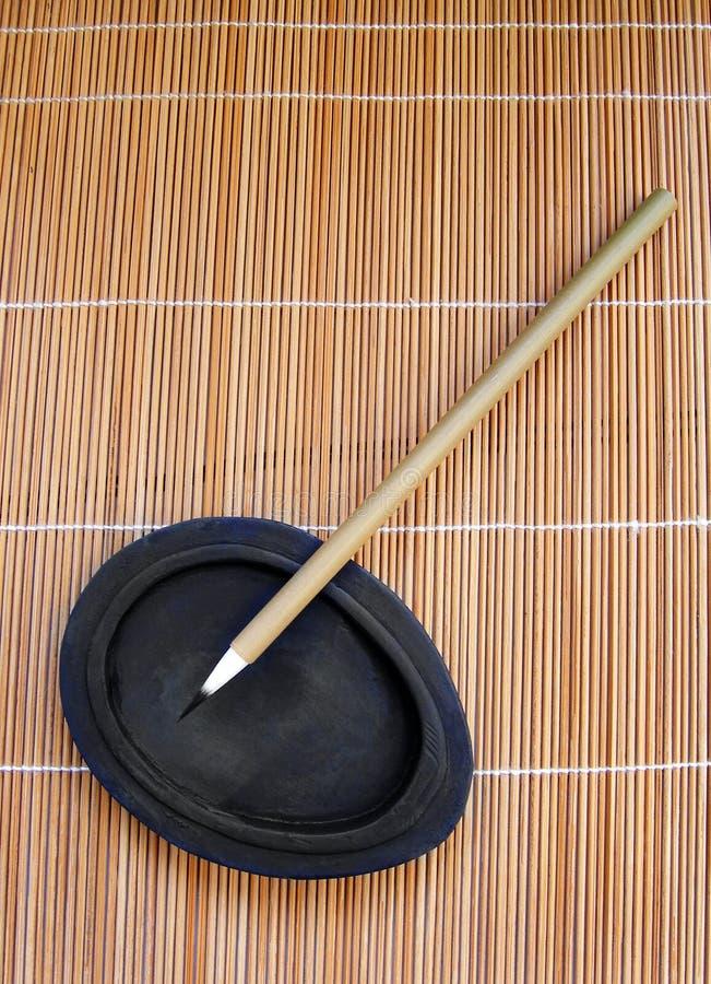 Cepillo de escritura de bambú para la caligrafía imagen de archivo