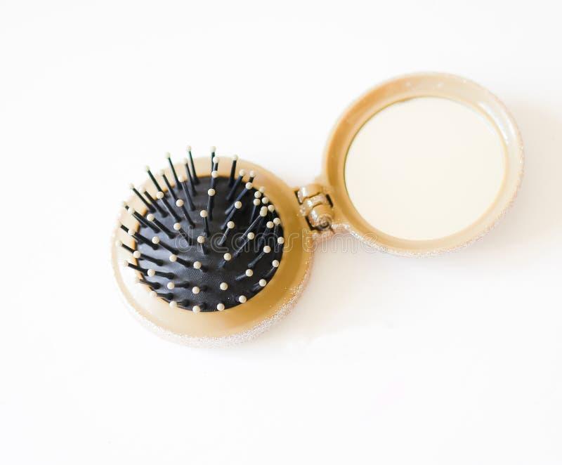 Cepillo de pelo plegable con el espejo fotos de archivo