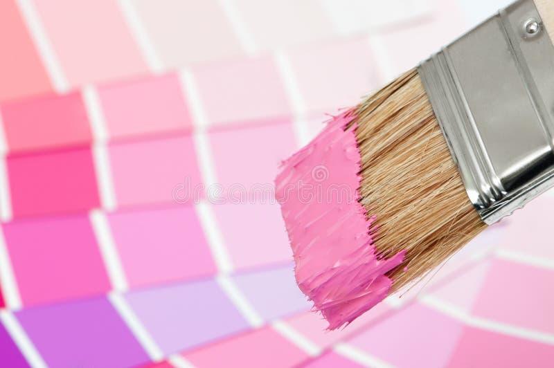 Cepillo de pintura - color de rosa imagenes de archivo