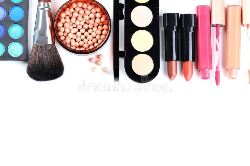 Cepillo y cosméticos del maquillaje foto de archivo