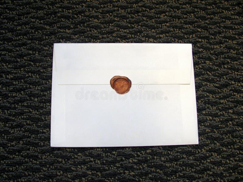 Cera do selo no envelope branco imagem de stock