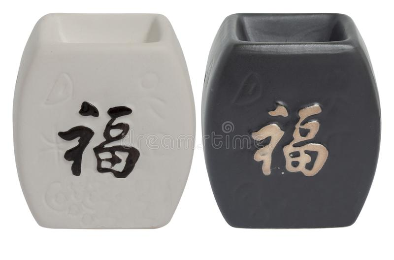 Ceramic aroma lamp for essential oils and tea lights. Isolated on a white background for a catalog. Black in oriental style stock image
