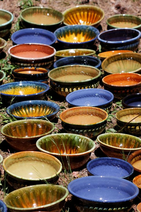 Ceramic art on Latvian Ethnographic open air museum. Beautiful colorful ceramic bowls for sale at Riga Open Air Museum art latvian ethnographic stock photos