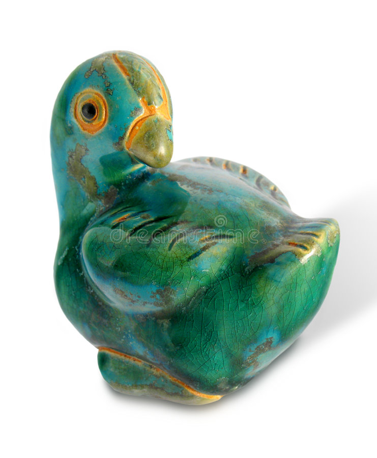 Ceramic Bird. Teal Green Rustic Ceramic Bird; Isolated with cast shadow stock photos