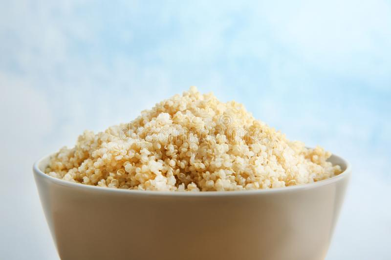Ceramic bowl with boiled sprouted. Organic white quinoa grains, closeup royalty free stock photo