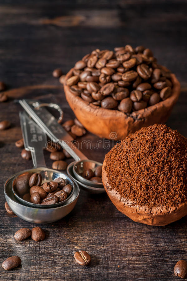 Ceramic bowl with coffee beans and ground coffee stock photos
