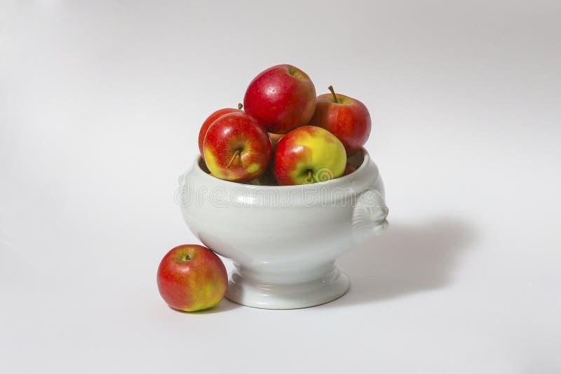 Ceramic bowl of fresh apples stock photo