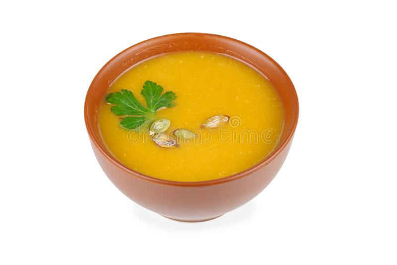 Ceramic bowl with pumpkin cream-soup royalty free stock photo