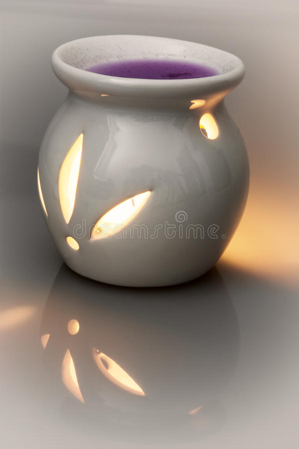 Ceramic candlestick with tealight candle and scented wax. Halloween theme royalty free stock photography