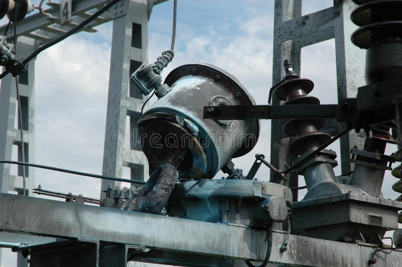 Ceramic conductors for electricity supply. Detail of high voltage substation, electricity supply, and ceramic conductors damaged after thunder strike, close up royalty free stock image