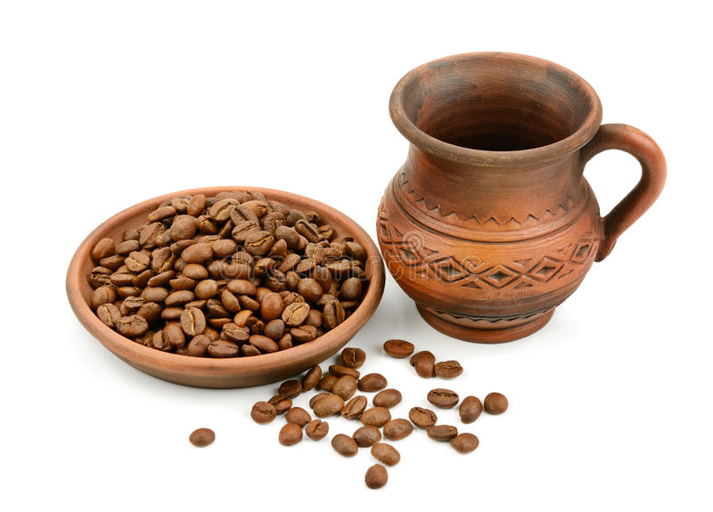 Ceramic cup of coffee beans stock photos
