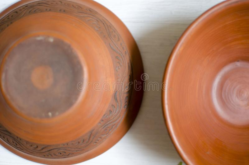 Download Ceramic Decorative Plates. Clay Dishes On The White Wooden Table Stock Photo - Image & Ceramic Decorative Plates. Clay Dishes On The White Wooden Table ...