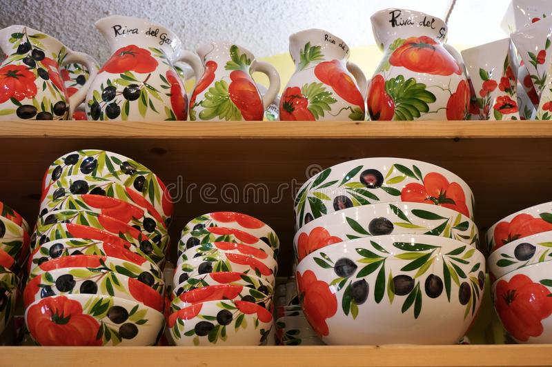 Ceramic dishes on the shelves in a store stock photography