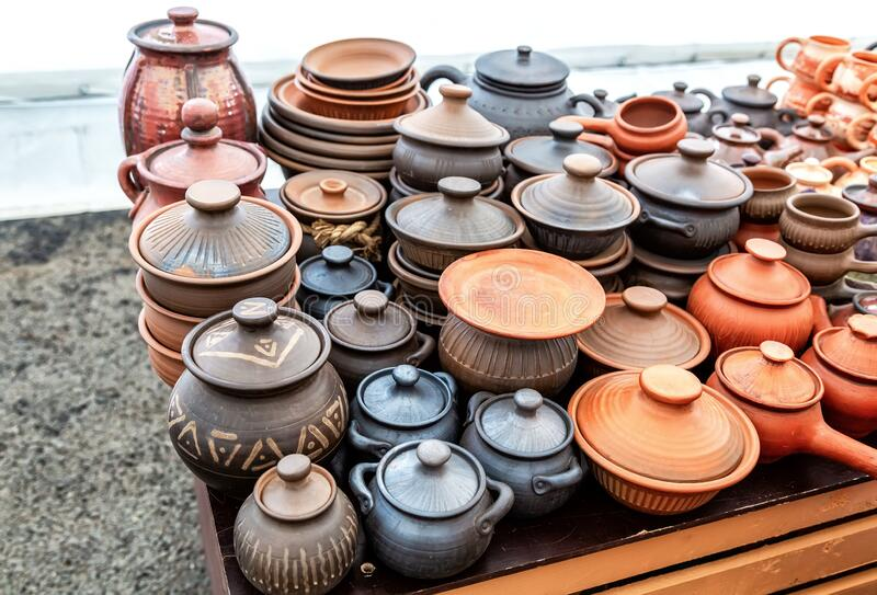 Ceramic dishes, tableware and pots sold on the market royalty free stock images