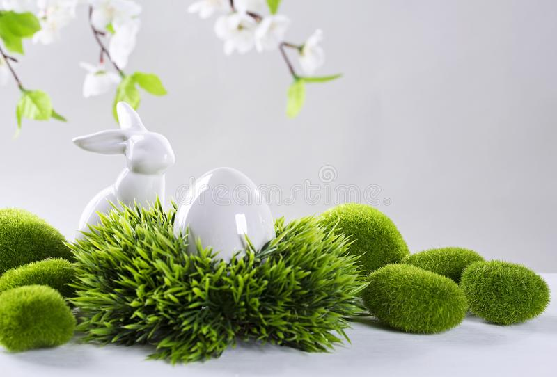 Ceramic easter rabbits and egg stock images