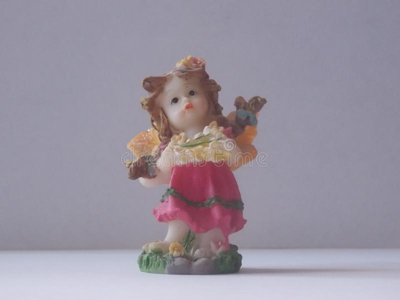 Ceramic figure of a girl on a white background stock photography