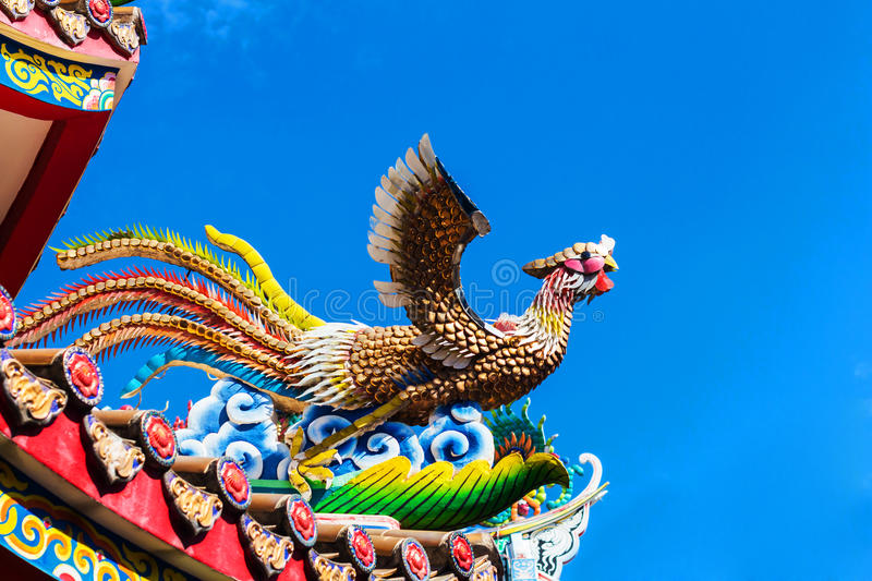 Ceramic fire bird on the roof of chinese royalty free stock image