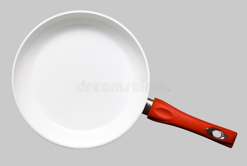 Ceramic frying pan. White ceramic frying pan on gray background royalty free stock photos