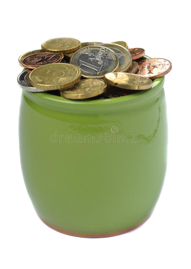 Ceramic green pot full of euro coins stock images