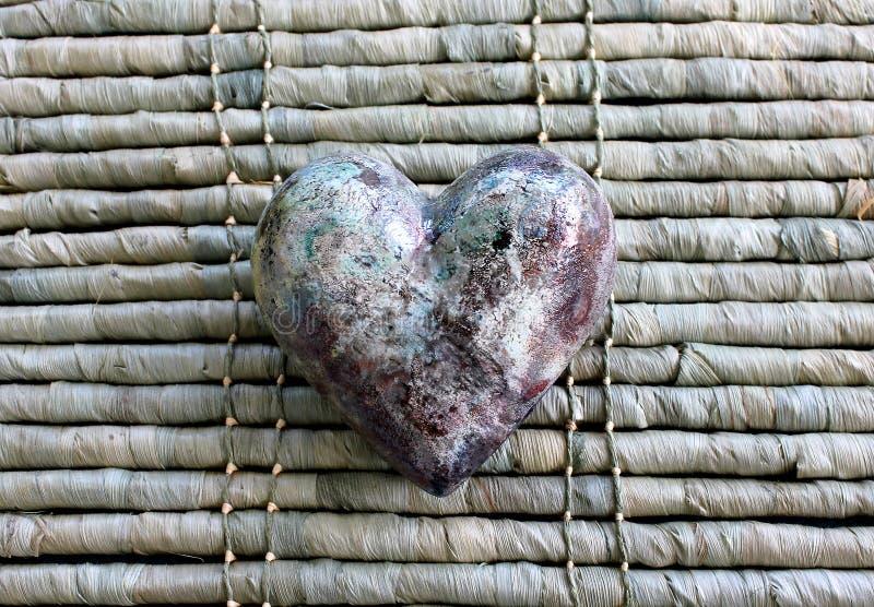Ceramic heart on bamboo stock photography