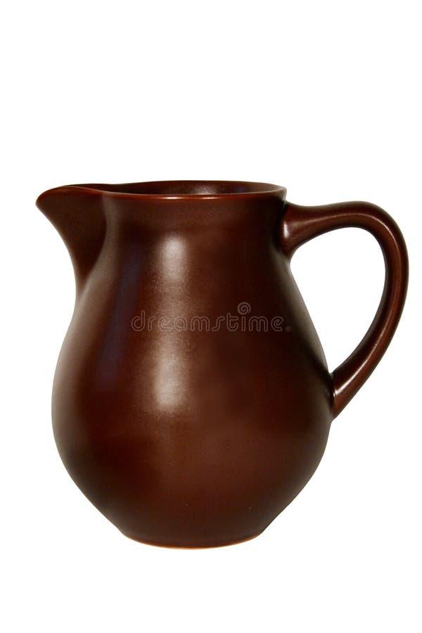 Ceramic jug. On white background stock image