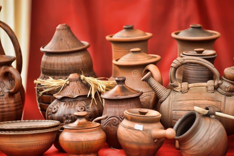 Ceramic jugs. National culture ceramic handmade brown jugs on market stock image