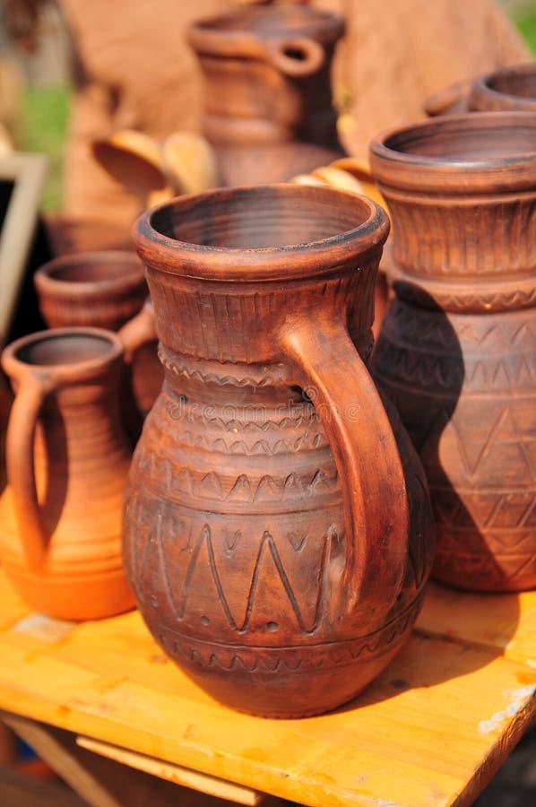 Ceramic jugs. National culture ceramic handmade brown jugs on market royalty free stock photo