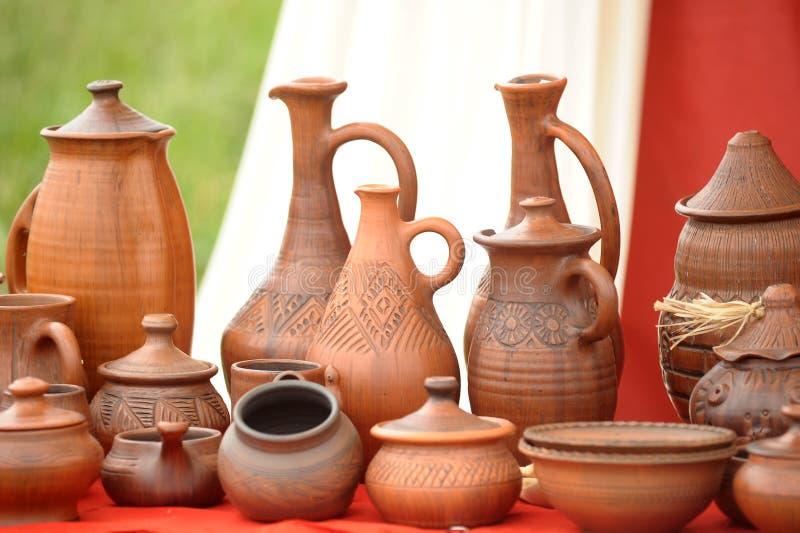 Ceramic jugs. National culture ceramic handmade brown jugs on market stock photography