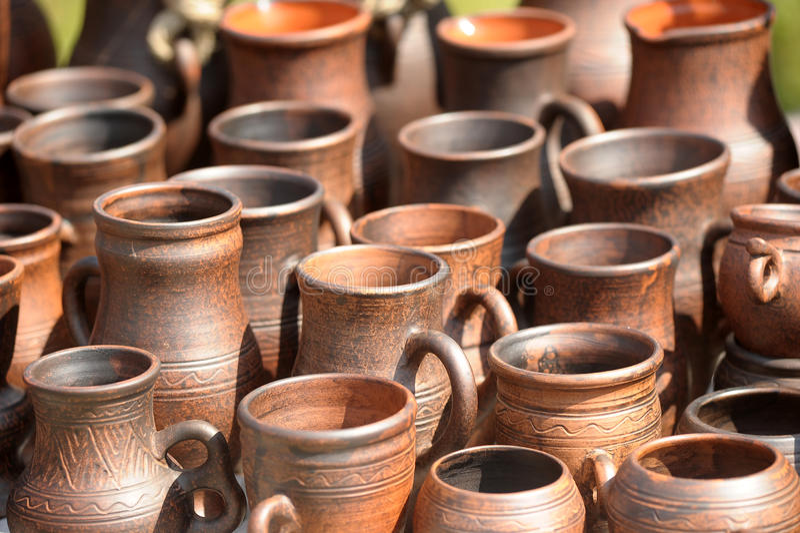 Ceramic jugs. National culture ceramic handmade brown jugs on market stock images