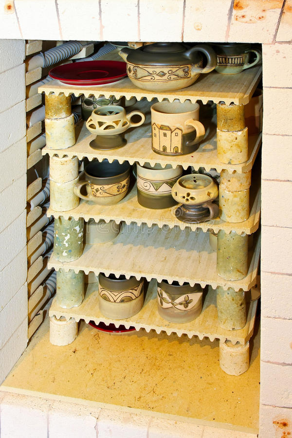 Ceramic kiln oven. Ceramic production kiln oven with cups and mugs stock images