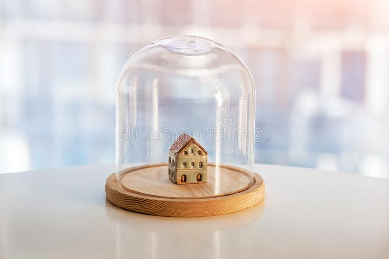 Ceramic model of house under glass cap royalty free stock photography
