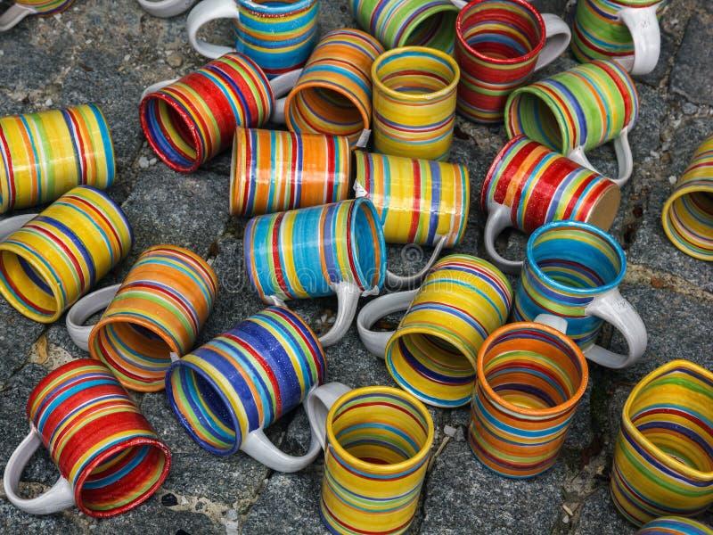 Ceramic mugs at market. stock photography