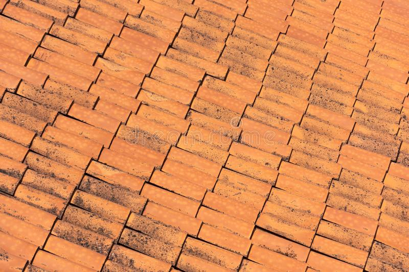 Ceramic orange clay tiles on the roof of a building.  royalty free stock image