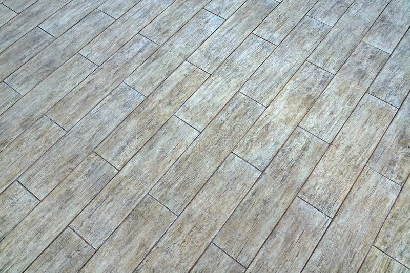 Ceramic Parquet Floor Tiles With Natural Ash Wood Textured Pattern. Background Or Texture With Space, Top View, Close Up, Diagonal Lines stock photography